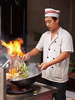 Chinese food: сhinese chef cooking a dish