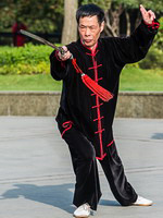 A man practicing Tai Chi in one of the parks of Shanghai, China