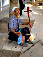 A street musician playing a stringed instrument, Beijing