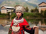 Population of China: The girl in national costume of Miao tribe