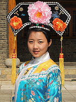 Population of China: A girl belonging to the Manchurian ethnic group in traditional dress