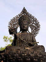 A bronze statue of Guan Yin in the large Chinese temple