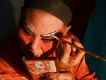 Chinese opera actor, does make-up before the show