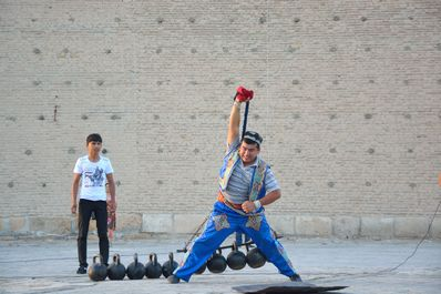Street Entertainer on the Registan square, Bukhara