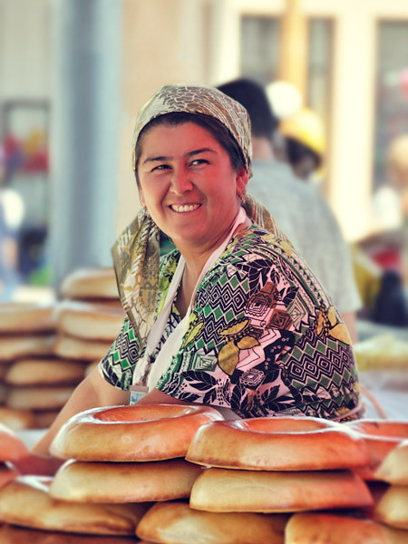 Saleswoman of the Samarkand bread, local market of Samarkand