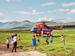 НThe Uruchcha Settlement. A helicopter of the Polar Airlines is landing