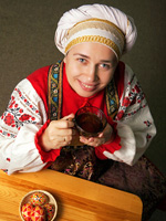 Woman in national russian costume, the celebration of Easter